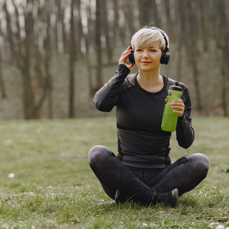 young woman listening to music B12