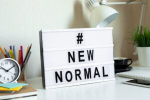 #NewNormal sign on a desk image for COVID 19: making a Will blog