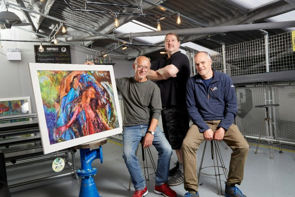 Artist Nick Coley (left), with his work The Goddess, and The Pumphouse Brewing Company Owners.