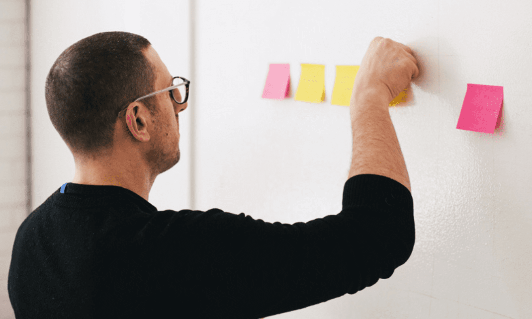 pinning notes to the wall